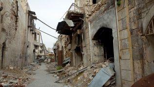 Zerstörung in der syrischen Stadt Aleppo. Bild: smallcreative / Shutterstock.com