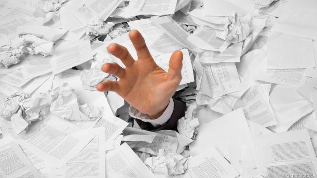 Unternehmen versinken im Papiermeer