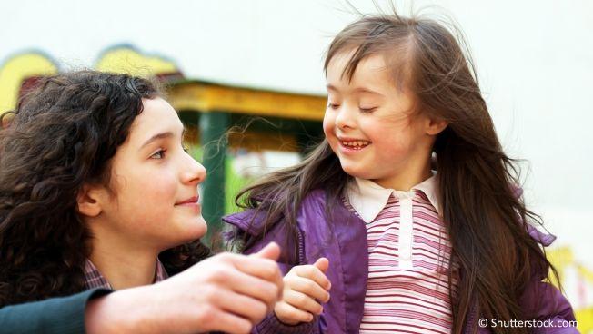 Mutter und Kind mit Down-Syndrom