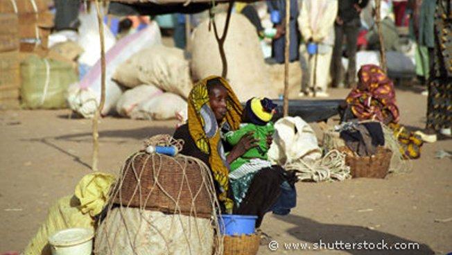 Afrikanische Mutter mit Kind